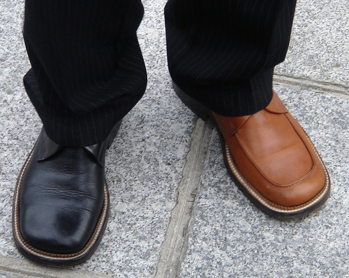 Wear mismatched shoes. It won't cheer you up, but it will definitely cheer up the people working near you