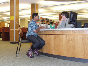 Reference librarian and patron